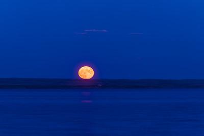 The Rising Strawberry Moon on the Horizon