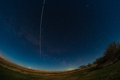 Space Station Pass in Moonlight