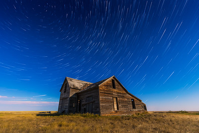 Star Trails over Rustic House