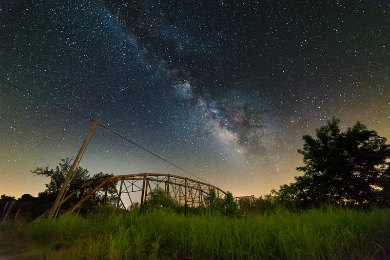 The Milky Way dominates the clear night sky over an old truss bridge near Calvin, OK, on July 4, 2014.
