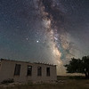 Composite image (foreground shot at dawn, sky in the late evening) of the Milky Way above an abandoned house near Clayton, New Mexico.