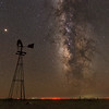 The Milky Way shines above windmills both old and new near Quay, New Mexico. This area has some of the darkest night skies in the continental United States, with even very small towns 30 or 40 miles apart.