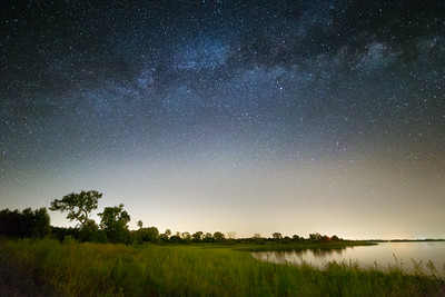 The Milky Way adds to a serene nighttime scene at the lake near Fort Cobb, OK.