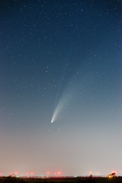 Comet NEOWISE is seen above a wind farm near Cogar, Oklahoma, at dusk on July 18, 2020.
