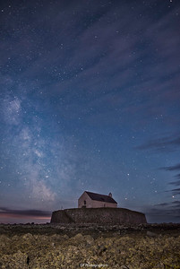 St Cwyfan Church Under the Stars with cloud rolling in