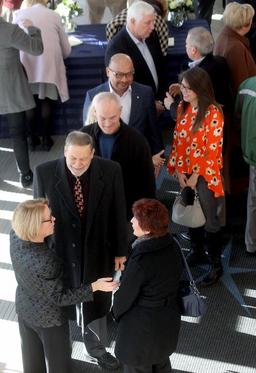 . Niki Tsongas, lower left, meets with folks at her farewell party in the Tsongas Center. SUN/ David H. Brow