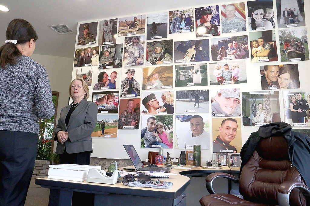 . Congresswoman Niki Tsongas, facing camera, chats with Leslie Lightfoot the Executive Director of the Veterans Homestead in Gardner on Tuesday morning, March 9, 2016. Behind Tsongas is a wall in Lightfoot\'s office of veterans that have use the homestead over the years. SENTINEL & ENTERPRISE/JOHN LOVE