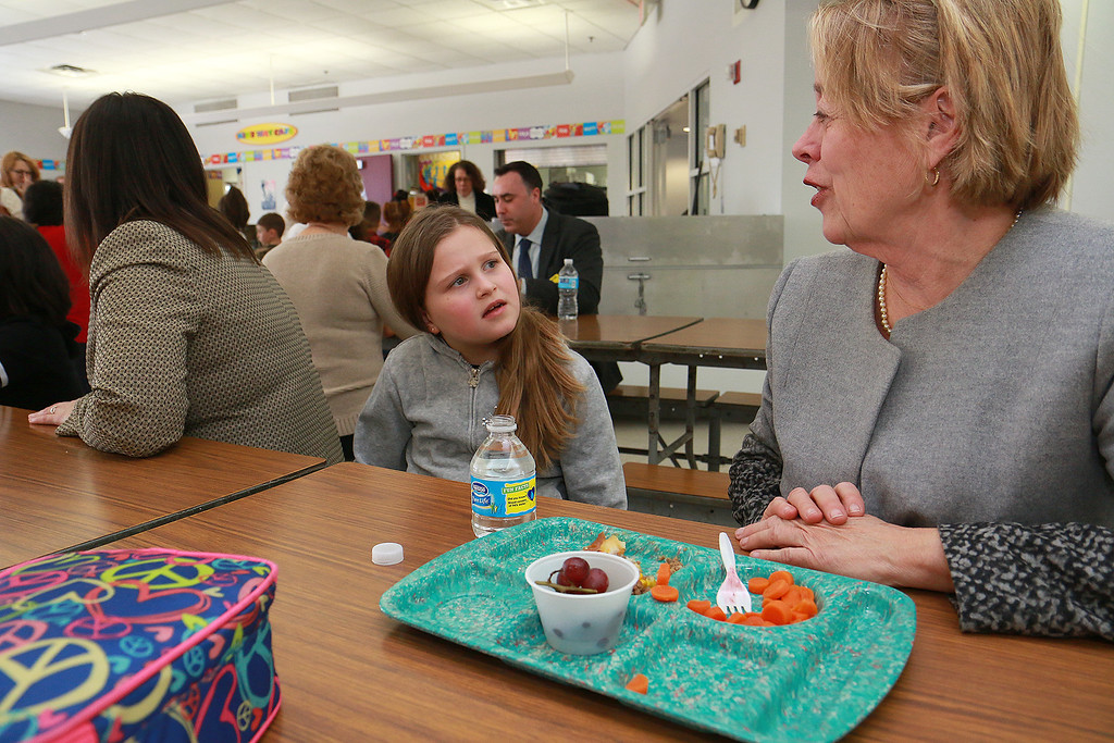 . Second grader Lillyan Marquez chats with Congresswoman Niki Tsongas as they have lunch together at the South Street Elementary School on Tuesday,  January 20, 2016. Congresswoman Niki Tsongas visited the South Street Elementary School and had lunch with the students to see one of the schools nutritional food program in Fitchburg. SENTINEL & ENTERPRISE/JOHN LOVE