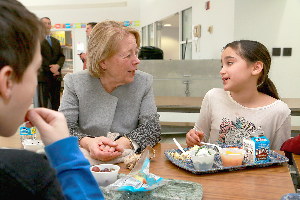 . Fourth grader Justena Caez chats with Congresswoman Niki Tsongas as they have lunch together at the South Street Elementary School on Tuesday, January 20, 2016. Congresswoman Niki Tsongas visited the South Street Elementary School and had lunch with the students to see one of the schools nutritional food program in Fitchburg. SENTINEL & ENTERPRISE/JOHN LOVE