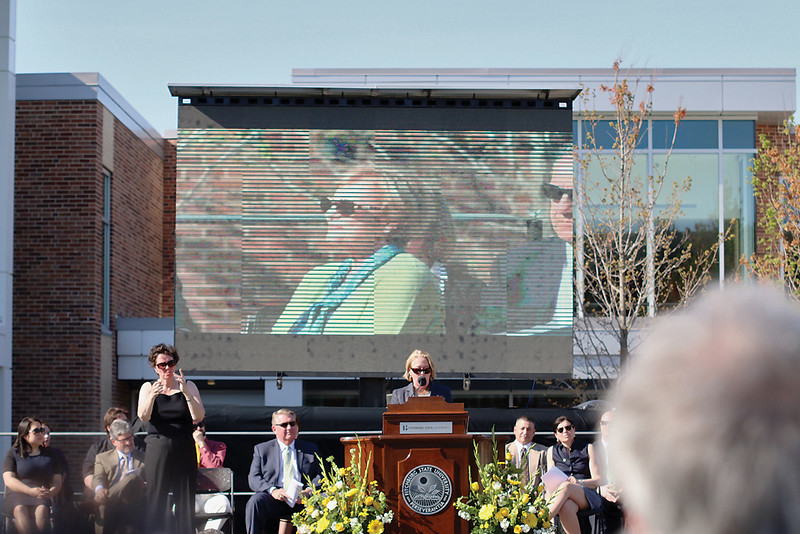 . The Dedication of the Robert V. & Jeanne S. Antonucci Science Complex was held Thursday afternoon, May 8, 2015, at the Fitchburg State University quadrangle. Jeanne Antonucci can be seen on the big screen listening to U.S. Representative Niki Tsongas as she address the importance of the sciences to the region and how students and companies will benefit greatly from the new science complex at FSU. SENTINEL & ENTERPRISE/ JOHN LOVE