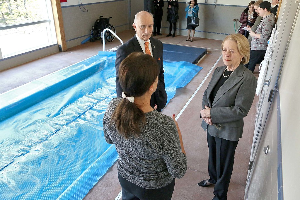 . Congresswoman Niki Tsongas and Mount Wachusett Community College President Daniel M. Asquino chats with Leslie Lightfoot the Executive Director of the Veterans Homestead in Gardner on Tuesday morning, March 9, 2016, as she talks about the facility near the pool they have for rehab. SENTINEL & ENTERPRISE/JOHN LOVE