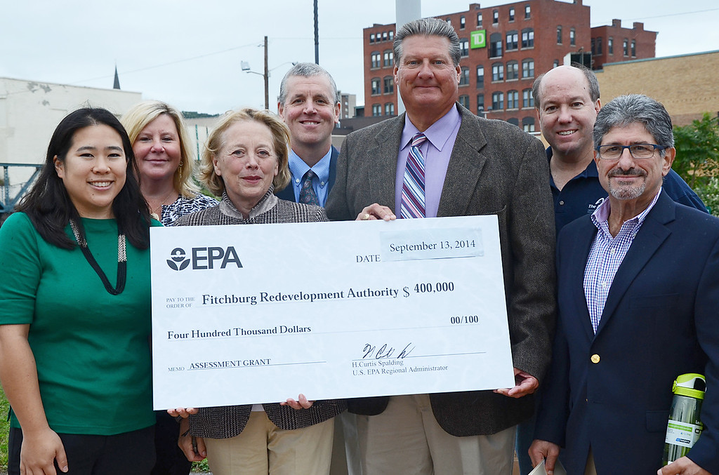 . Fitchburg Mayor Lisa Wong, Chrstine Lombard, of the EPA, Congresswoman Niki Tsongas, Jim Byne, of the EPA, Dan Curley, Executive Director of the Fitchburg Redevelopment Authority, Jim Holman, also of the Redevelopment, and State Representative Stephen DiNatale, and Fitchburg Mayor Lisa Wong at the Eighth Annual River Day on Saturday afternoon September 14, 2014. A 400, 000 check was presented to the Fitchburg Redevelopment Authority from the EPA. SENTINEL & ENTERPRISE / Ashley Green