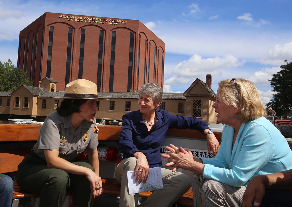 . Secretary of the Interior Sally Jewell joins U.S. Rep. Niki Tsongas for her annual River Day, taking a canal boat ride at Lowell National Historical Park. From left, Lowell National Historical Park superintendent Celeste Bernardo, Jewell and Tsongas talk at the end of the boat ride. (SUN/Julia Malakie)