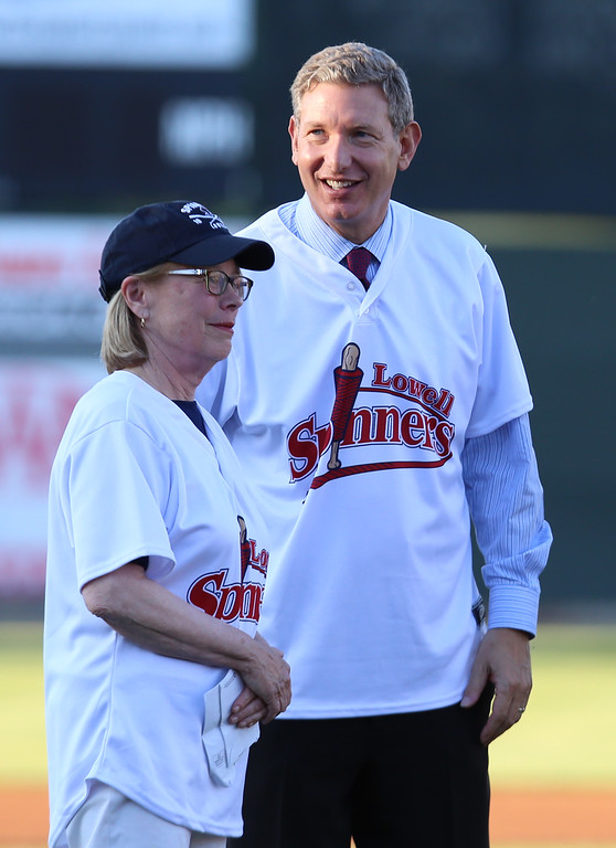 . Rep. Niki Tsongas throws out the first pitch of the 2016 Lowell Spinners season with new owner Dave Heller. (SUN/Julia Malakie)