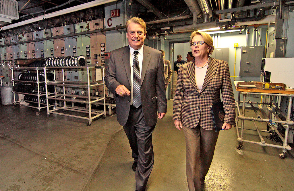 . Rep. Niki Tsongas visits Specialty Materials in Lowell in 2011, walking with company president Monte Treasure. SUN/David H. Brow.