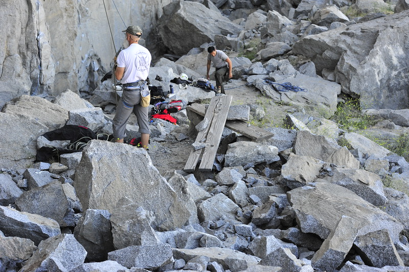 A large bolder fell from the top of the RQ ... it exploded when it hit spreading debris ... destroying seating, steps and covering the trail.