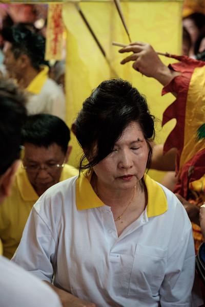 local women receiving a blessing