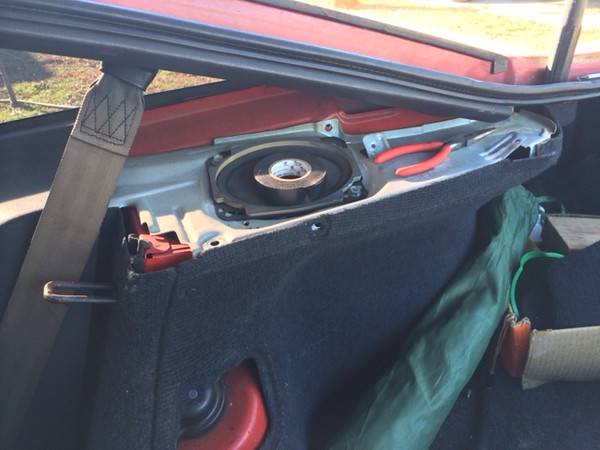 Trim panels removed.  Factory speaker shown.