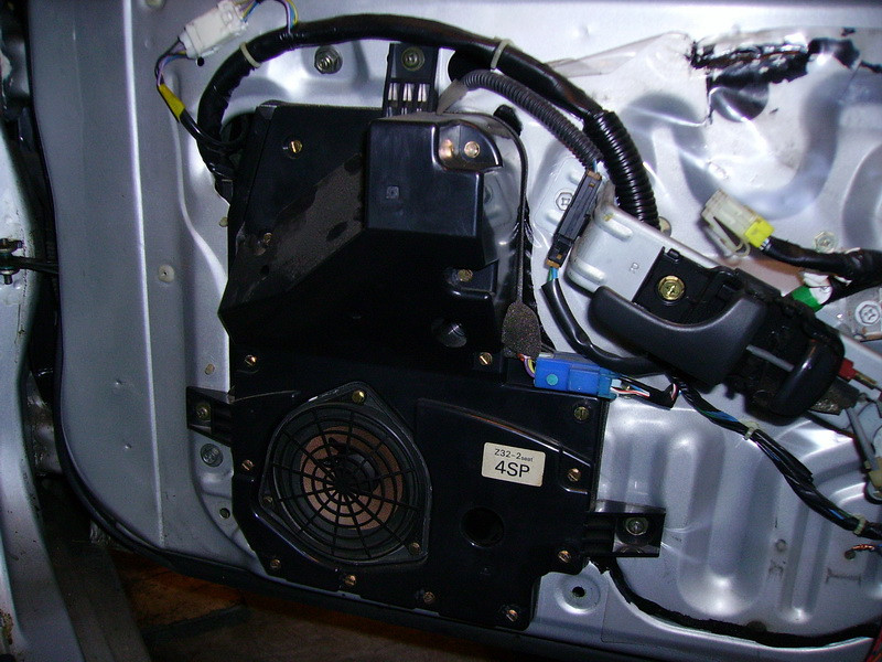 Factory Bose speaker and enclosure installed on passenger side of vehicle