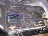 Amplifier installed under passenger side seat