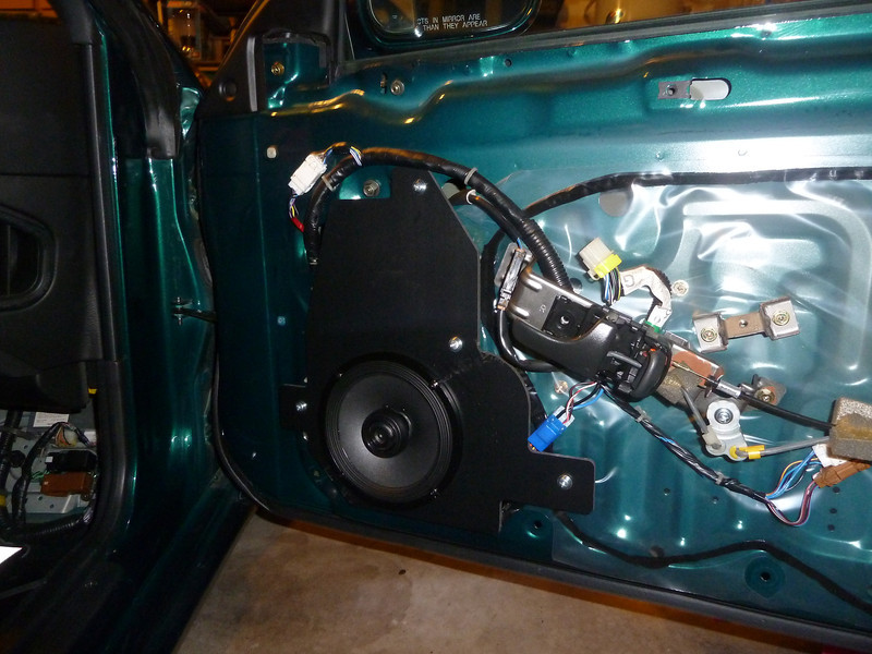 "Aftermarket speaker and speaker adapter plate  from  <a href=""http://www.car-speaker-adapters.com/items.php?id=SAK005""> Car-Speaker-Adapters.com</a>   installed on door"