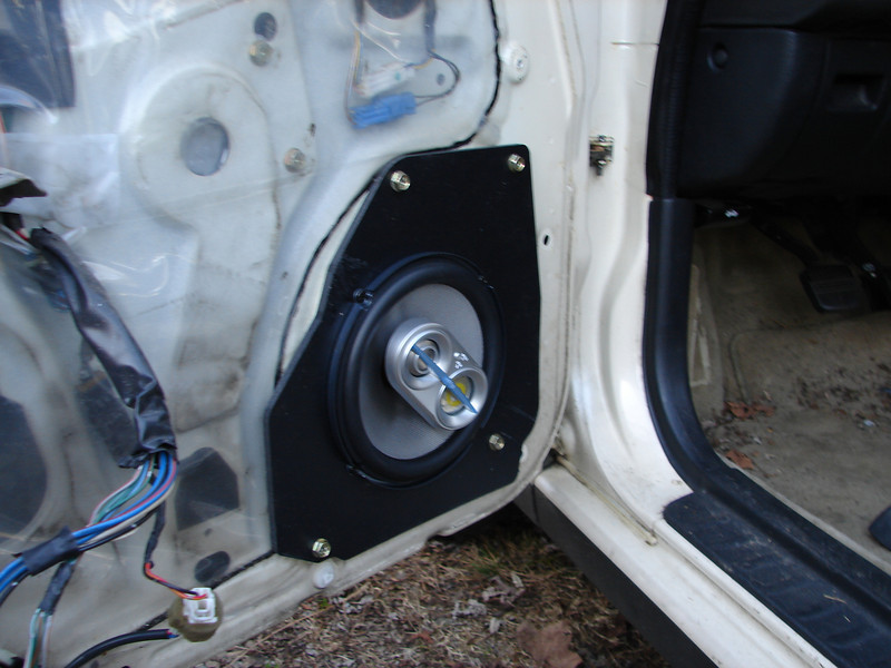 """Aftermarket 3-way speakers and speaker adapters from  <a href=""""http://www.car-speaker-adapters.com"""">http://www.car-speaker-adapters.com</a> installed in door."""