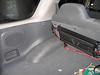 Kicker amplifier installed behind rear seat.