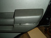 Arm rest separated from door panel