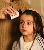 """Nitty Gritty Head Lice Range.<br /> Apply NItty Gritty Head Lice Solution to hair and comb through.<br /> Oakwood Remedies <br />  <a href=""""http://www.nittygritty.co.uk"""">http://www.nittygritty.co.uk</a><br /> amanda@nittygritty.co.uk<br /> Press and PR dani@needtoknowpr.co.uk<br />  <a href=""""http://www.picandmiximages.co.uk"""">http://www.picandmiximages.co.uk</a><br /> © Amanda Coplans"""