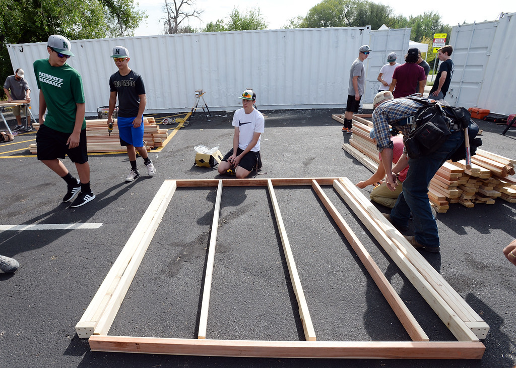 . NIWOT, CO - AUGUST 25:   Niwot High School students help build classroom container buildings that will be used to address overcrowding at Niwot Elementary\'s partner school in Uganda through the Mwebaza Foundation for the last 10 years, Mwebaza Primary School. The Mwebaza Foundation, which started at Niwot Elementary, is working with the nonprofit, Homes of Living Hope, to coordinate this project. Homes of Living Hope sends shipping containers all over the world for use as schools, clinics, etc. on August 25, 2018.  (Photo by Cliff Grassmick/Staff Photographer)