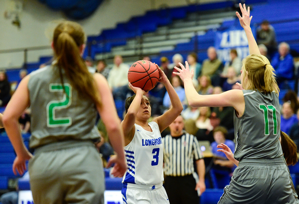 . LONGMONT, CO - FEBRUARY 1:Longmont High School\'s Emily Sanchez (No. 3) shoots between Niwot High School\'s Nikki Sims (No. 2) and Mackenzie Demmel (No. 11) in Longmont on Feb. 1, 2019. (Photo by Matthew Jonas/Staff Photographer)