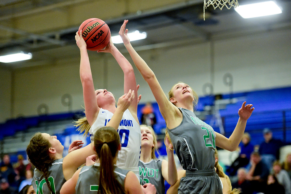 . LONGMONT, CO - FEBRUARY 1:Longmont High School\'s Annika Wetterstrom (No. 10) grabs a rebound while covered by Niwot High School\'s Marlow Baines (No. 21) in Longmont on Feb. 1, 2019. (Photo by Matthew Jonas/Staff Photographer)