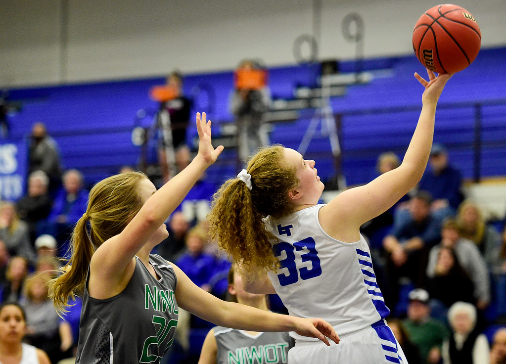 . LONGMONT, CO - FEBRUARY 1:Longmont High School\'s Emmelia Ashton (No. 33) puts up a shot past Niwot High School\'s Brynn Beaton (No. 20) in Longmont on Feb. 1, 2019. (Photo by Matthew Jonas/Staff Photographer)