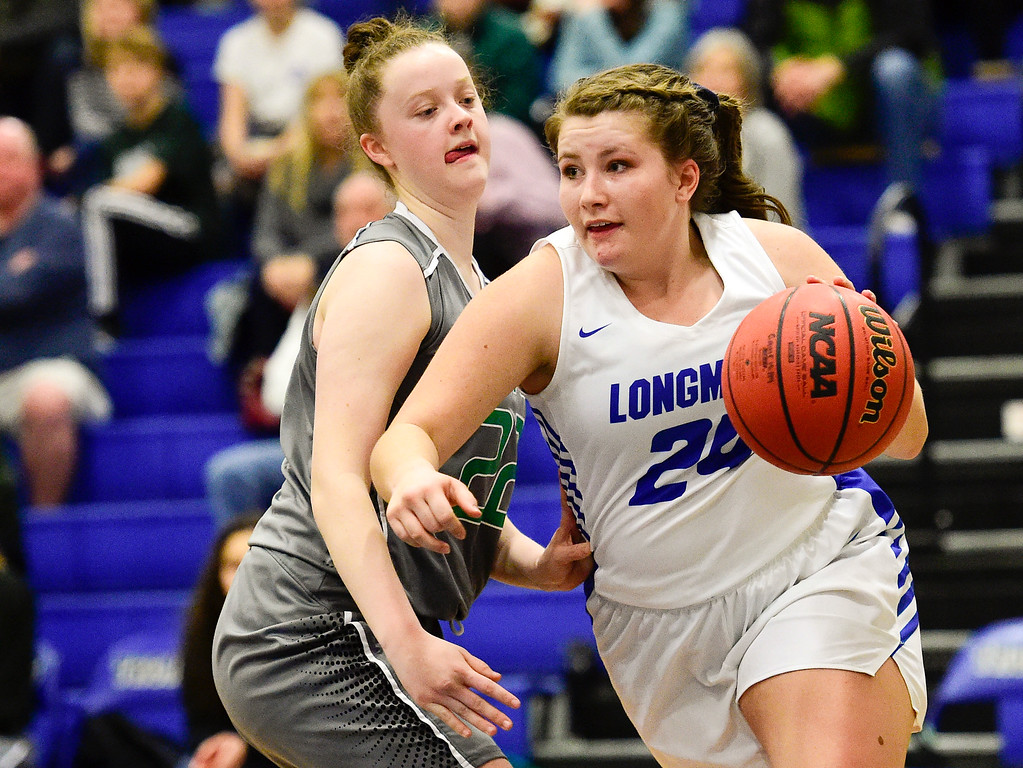 . LONGMONT, CO - FEBRUARY 1:Longmont High School\'s Tanna Carson (No. 24) drives around Niwot High School\'s Lily Sieben (No. 22) iin Longmont on Feb. 1, 2019. (Photo by Matthew Jonas/Staff Photographer)