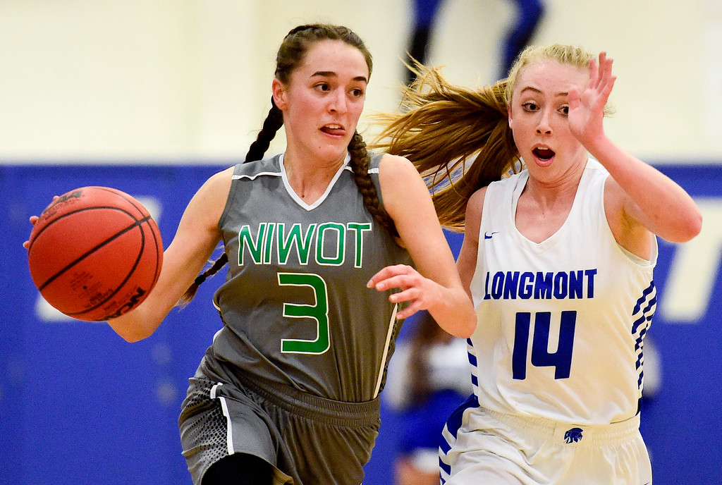 . LONGMONT, CO - FEBRUARY 1:Niwot High School\'s Elise Crall (No. 3) drives around Longmont High School\'s Sarah Wormke (No. 14) in Longmont on Feb. 1, 2019. (Photo by Matthew Jonas/Staff Photographer)