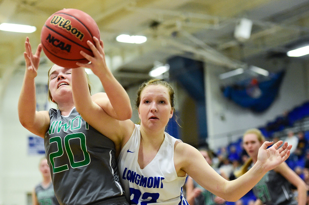 . LONGMONT, CO - FEBRUARY 1:Longmont High School\'s Ashley Dillow (No. 22) Niwot High School\'s Brynn Beaton (No. 20) battle for a rebound in Longmont on Feb. 1, 2019. (Photo by Matthew Jonas/Staff Photographer)