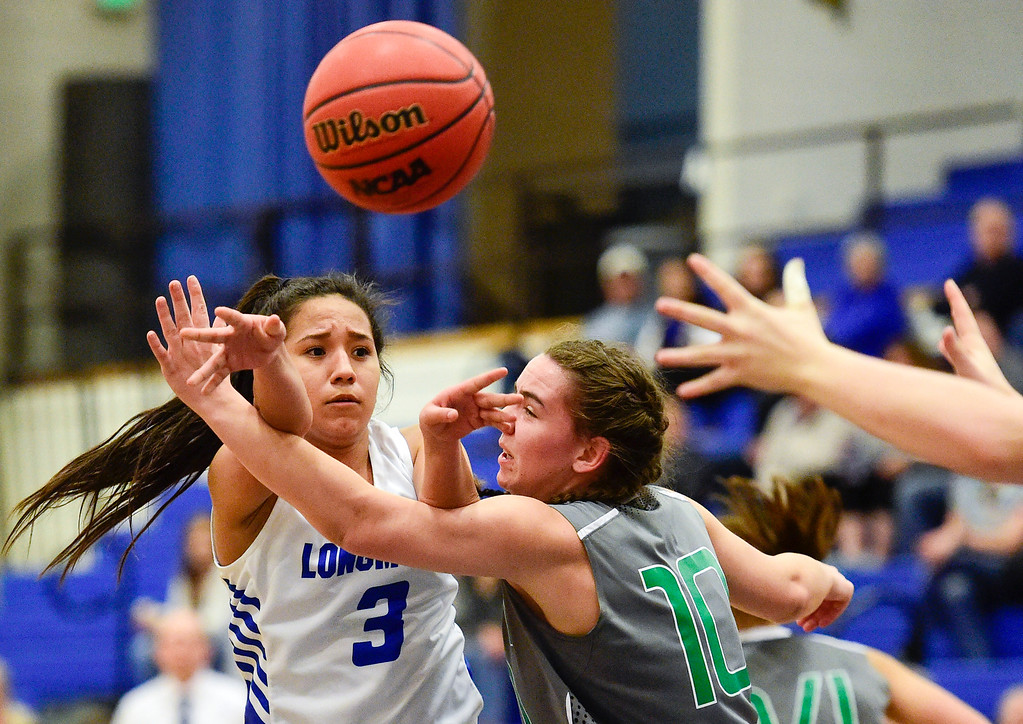 . LONGMONT, CO - FEBRUARY 1:Longmont High School\'s Emily Sanchez (No. 3) passes through the arms of Niwot High School\'s Bitsy Archibold (No. 10) in Longmont on Feb. 1, 2019. (Photo by Matthew Jonas/Staff Photographer)