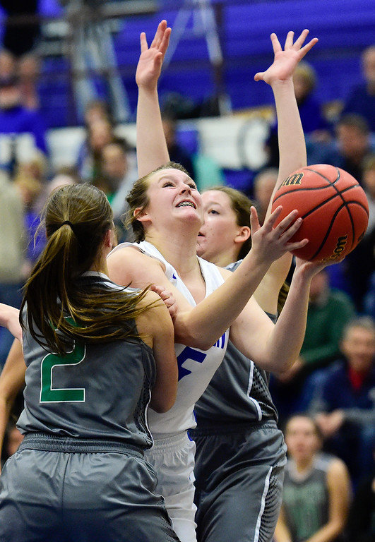 . LONGMONT, CO - FEBRUARY 1:Longmont High School\'s Shaelee Gray (No. 5) puts up a shot between Niwot High School\'s Nikki Sims (No. 2) and Rachel Noble (No. 0) in Longmont on Feb. 1, 2019. (Photo by Matthew Jonas/Staff Photographer)