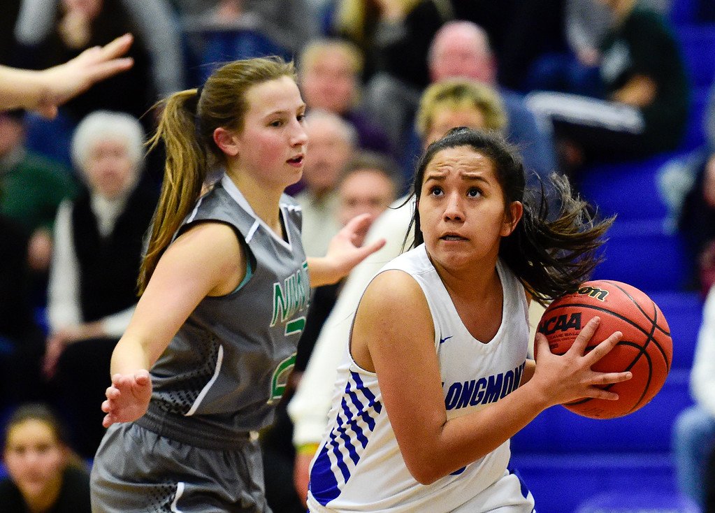 . LONGMONT, CO - FEBRUARY 1:Longmont High School\'s Emily Sanchez (No. 3) looks to pass while covered by Niwot High School\'s Nikki Sims (No. 2) in Longmont on Feb. 1, 2019. (Photo by Matthew Jonas/Staff Photographer)