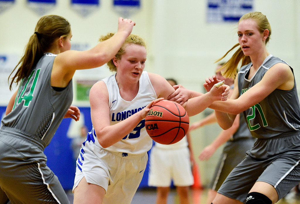 . LONGMONT, CO - FEBRUARY 1:Longmont High School\'s Emmelia Ashton (No. 33) drives through Niwot High School\'s Grace Wardle (No. 14) and Marlow Baines (No. 21) in Longmont on Feb. 1, 2019. (Photo by Matthew Jonas/Staff Photographer)