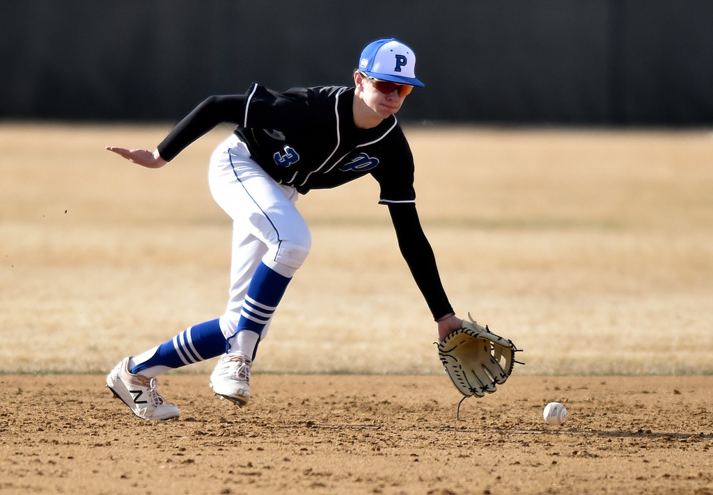 . NIWOT, CO - MARCH 19, 2019: Peak to Peak High School\'s Garrett Shriver stops a ground ball for an out at first base during a non-league game against Niwot on Tuesday in Niwot. For more photos of the game go to: BoCoPreps.com (Photo by Jeremy Papasso/Staff Photographer)
