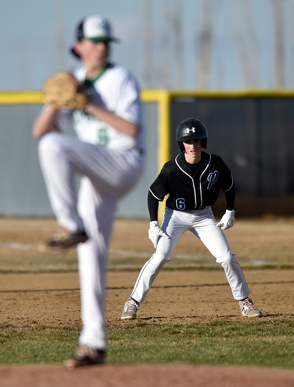. NIWOT, CO - MARCH 19, 2019: Peak to Peak High School\'s Sam Custard gets a lead at first base during a non-league game against Niwot on Tuesday in Niwot. For more photos of the game go to: BoCoPreps.com (Photo by Jeremy Papasso/Staff Photographer)