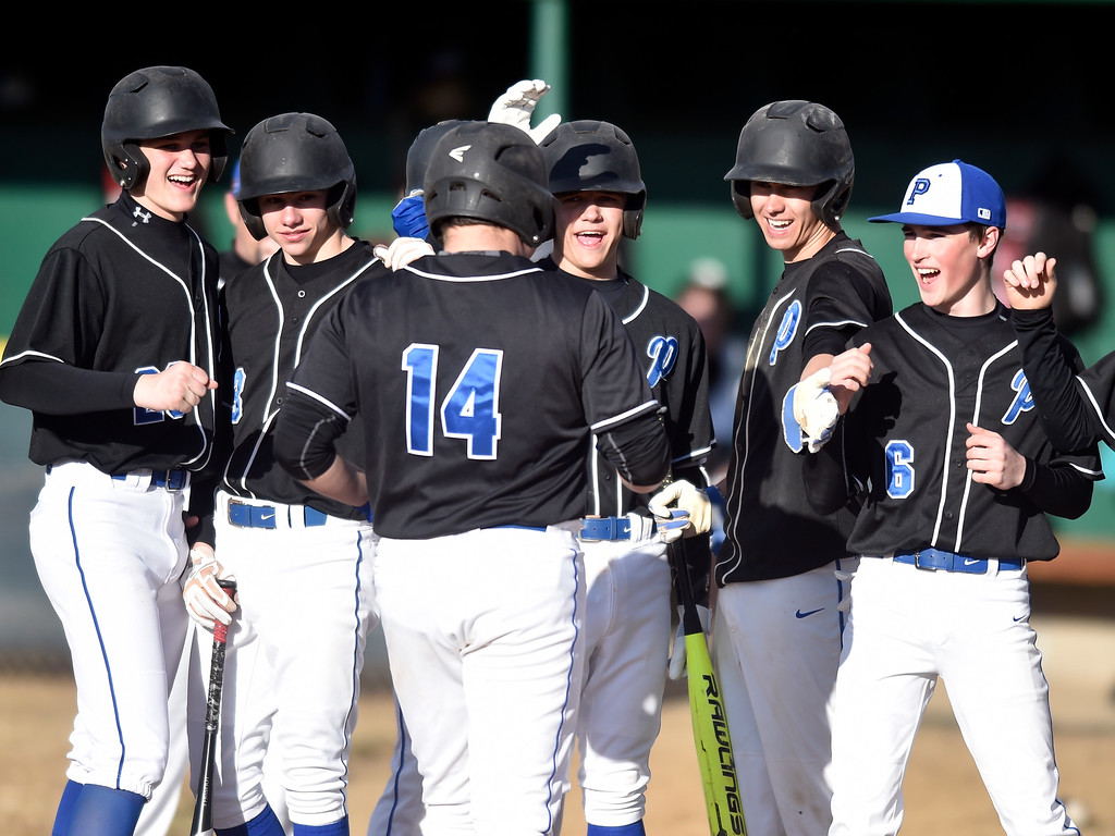 . NIWOT, CO - MARCH 19, 2019: Peak to Peak High School\'s Nathan Poretz is congratulated by teammates after hitting a home-run during a non-league game against Niwot on Tuesday in Niwot. For more photos of the game go to: BoCoPreps.com (Photo by Jeremy Papasso/Staff Photographer)