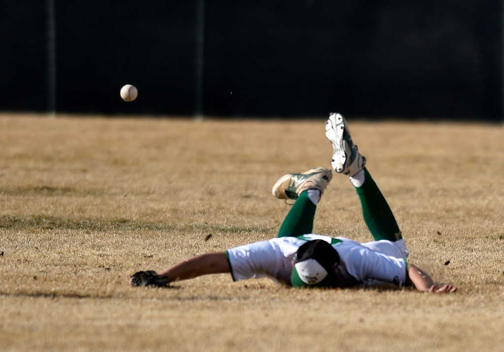 . NIWOT, CO - MARCH 19, 2019: Niwot High School\'s Aidan Galloway faceplants after missing a diving catch attempt during a non-league game against Peak to Peak on Tuesday in Niwot. For more photos of the game go to: BoCoPreps.com (Photo by Jeremy Papasso/Staff Photographer)