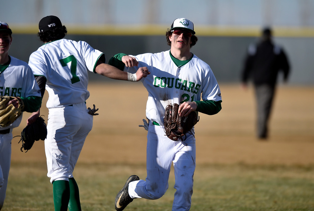 . NIWOT, CO - MARCH 19, 2019: Niwot High School\'s Nick yard, at right, is congratulated by Felipe Castro after making a diving catch in right field during a non-league game against Peak to Peak on Tuesday in Niwot. For more photos of the game go to: BoCoPreps.com (Photo by Jeremy Papasso/Staff Photographer)