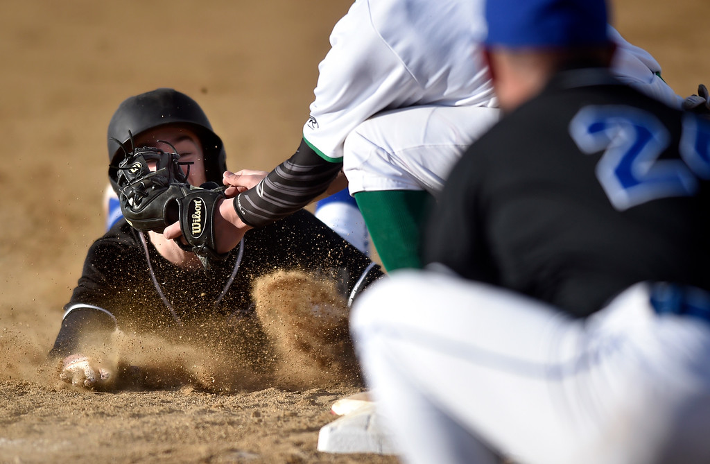 . NIWOT, CO - MARCH 19, 2019: Peak to Peak High School\'s Garrett Shriver is tagged out at third base by Felipe Castro during a non-league game against Niwot on Tuesday in Niwot. For more photos of the game go to: BoCoPreps.com (Photo by Jeremy Papasso/Staff Photographer)