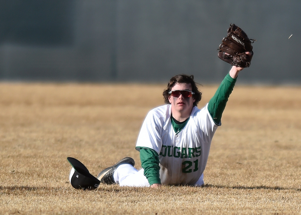 . NIWOT, CO - MARCH 19, 2019: Niwot High School\'s Nick yard shows the umpire the ball after making a diving catch in right field during a non-league game against Peak to Peak on Tuesday in Niwot. For more photos of the game go to: BoCoPreps.com (Photo by Jeremy Papasso/Staff Photographer)