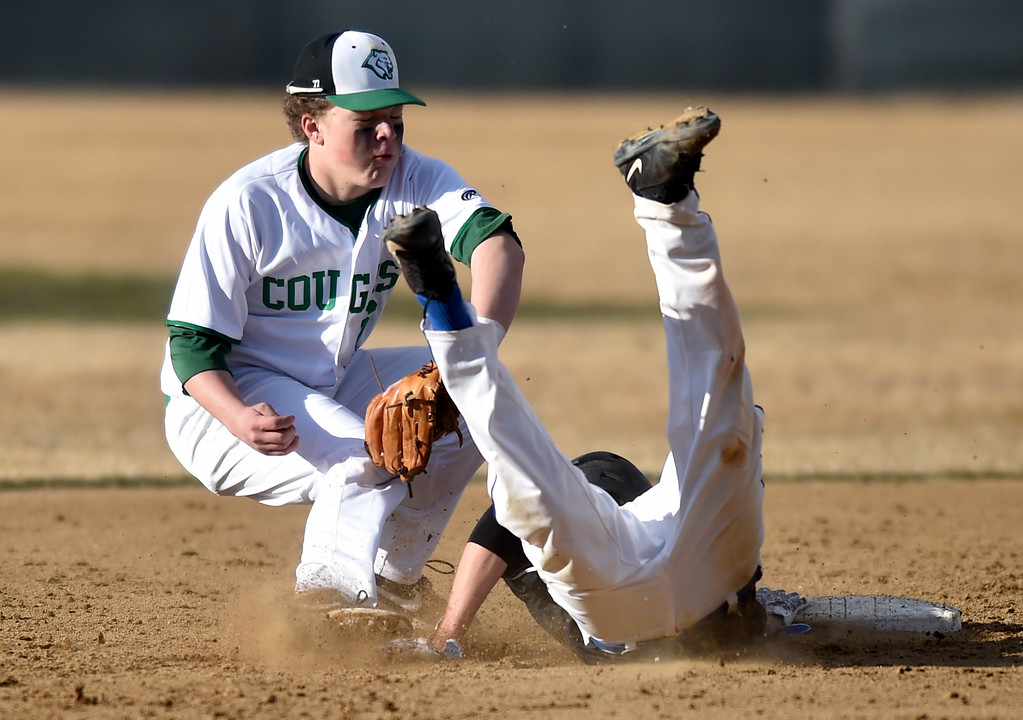 . NIWOT, CO - MARCH 19, 2019: Peak to Peak High School\'s Isaac Van Tol dives into seconds base safely under the tag of Taylor Goldfarb during a non-league game against Niwot on Tuesday in Niwot. For more photos of the game go to: BoCoPreps.com (Photo by Jeremy Papasso/Staff Photographer)