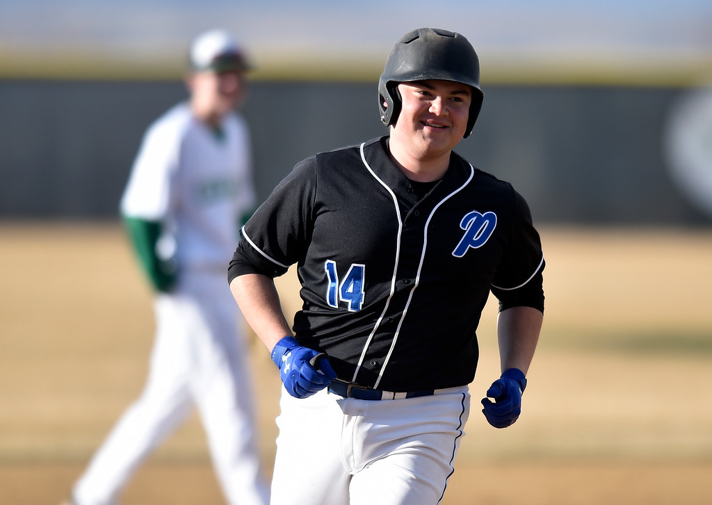 . NIWOT, CO - MARCH 19, 2019: Peak to Peak High School\'s Nathan Poretz smiles as he rounds the bases after hitting a home-run during a non-league game against Niwot on Tuesday in Niwot. For more photos of the game go to: BoCoPreps.com (Photo by Jeremy Papasso/Staff Photographer)