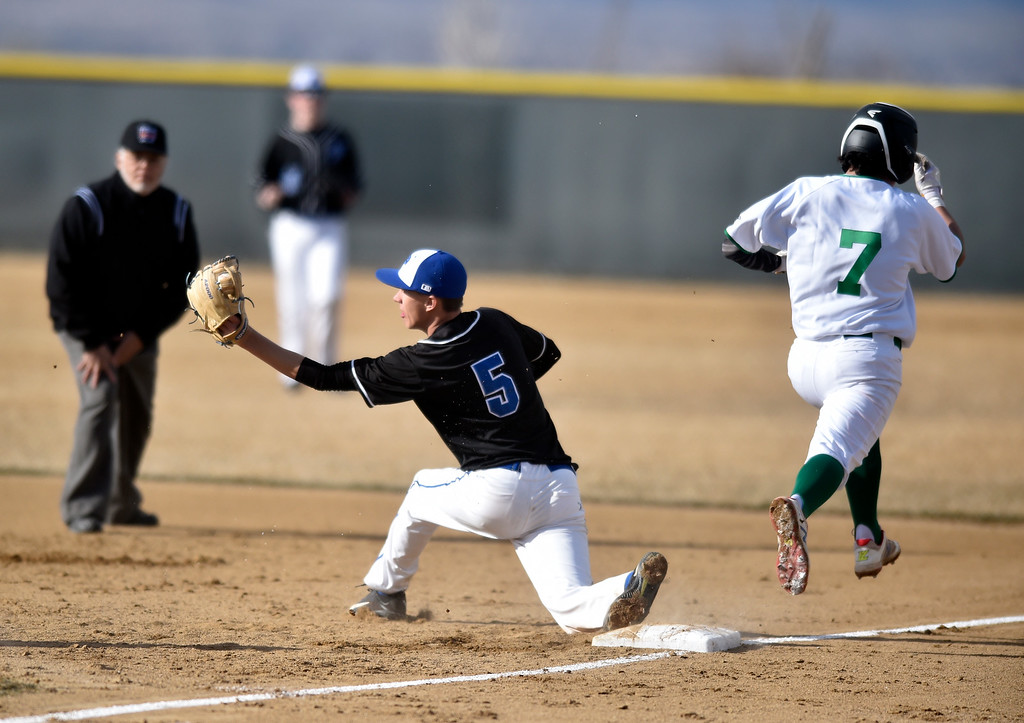 . NIWOT, CO - MARCH 19, 2019: Niwot High School\'s Felipe Castro, No. 7, beats the throw to first base during a non-league game against Peak to Peak on Tuesday in Niwot. For more photos of the game go to: BoCoPreps.com (Photo by Jeremy Papasso/Staff Photographer)